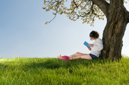 Read a book sitting under a blossom tree